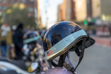 Police Helmet With American Flag Sticker Hanging Off A Police Scooter On A New York City Street