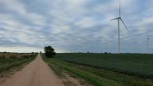 Wind Turbines In Soybean Field...