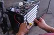 auto electrician checks car components