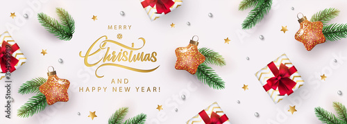 Christmas banner. Xmas background design with star shaped christmas toy, realistic gifts box, fir branch, glitter gold confetti. Horizontal New Year poster, greeting card, header, website. Top view  - 304959989