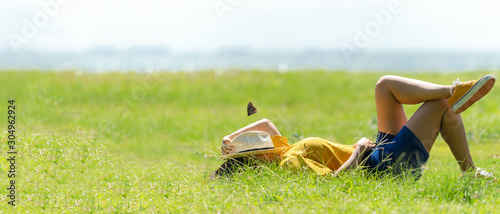 Obraz Woman relax and sleep chill  in the meadow  outdoor near sea beach.  Lifestyle and Vacations Concept - fototapety do salonu