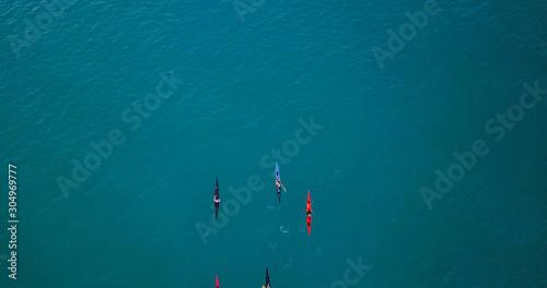 Obraz na plátně Aerial image of kayakers paddling forwards