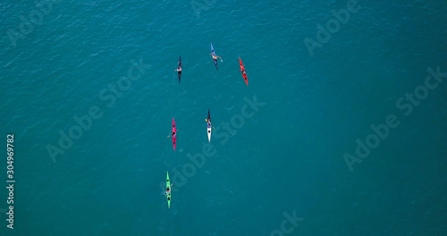 Fotografie, Obraz Aerial image of kayakers paddling forwards