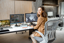 Portrait Of A Young Creative Office Employee Making Interior Design, 3d Modeling On The Computer While Sitting At The Modern Office Of Architectural Firm