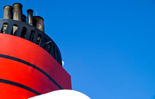 Red And Black Funnel Of Classic Ocean Liner Cruise Ship Cunard Queen Elizabeth Queen Victoria Against Deep Blue Sky During Cruise In Summer