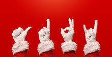 Four Santa's Hands In White Gl...