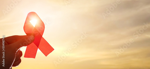 Red ribbon symbol of AIDS and HIV disease.