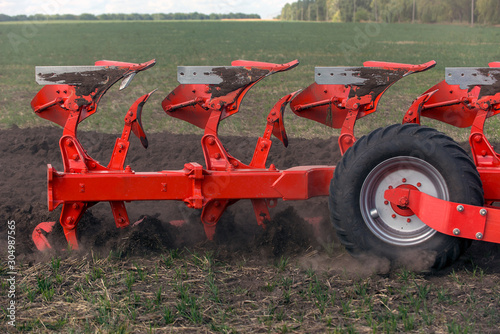 technology of preparing soil for sowing, plow plowing the land Wallpaper Mural