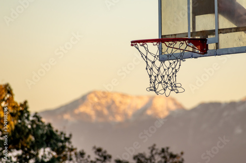 A basketball hoop with the mountain range in the background; Chail Ground, Rasht Wallpaper Mural