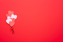 Valentine's Day Background With Red And Pink Hearts Like Balloons On Red Background, Flat Lay, Top-down View