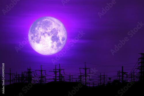 full milk moon purple back on silhouette electric pole on night sky Canvas Print
