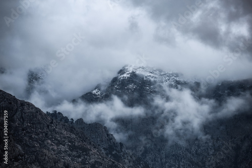 Fotografering  Clouds over Monte Grosso in Corsica