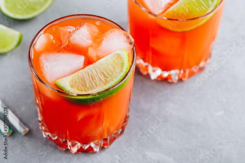 Fotografie, Obraz  Carrot Ginger Margarita cocktail with lime in glass