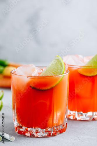 Fototapeta  Carrot Ginger Margarita cocktail with lime in glass