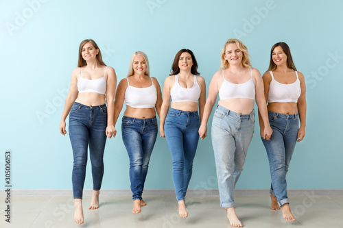 Photo Group of body positive women near color wall