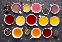 Assortment Of Tea Cups On Dark, Stone Background, Top View
