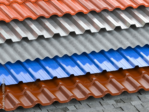 Fototapeta Different types of roof coating. Background from layers of sheet metal  profiles, ceramic tiles, asphalt roofing shingles and gypsum slate. obraz