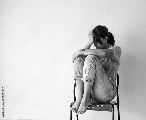 Photo The loneliness woman raised hand touch her head,sad and tried feeling,upset and tried,negative emotion,the Depressive disorder syndrome,black and white tone