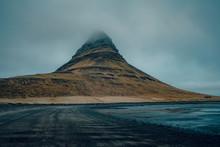 Kirkjufellsfoss Waterfall Next To Mount Kirkjufell In Iceland