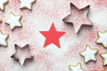 Flat Lay Of Christmas Star Cookies With Cutters And Sugar Powder In Form Of Snow On Red Background Minimal Creative Concept.