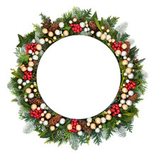 Christmas Table Setting With Round Porcelain Plate, Silver & Gold Baubles, Snow Covered Fir, Holly, Mistletoe, Ivy, Pine Cones & Cedar Leaves On White Background.