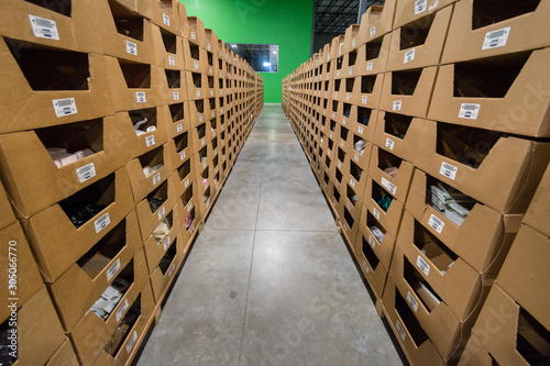 Photo Goods in aisles of picking shelves in warehouse depot