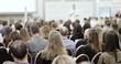 Seminar, meeting, training, conference in group. Public speech concept. Educational finance lectures for startuppers. Business training with man speaker talking in large audience, view from viewers.