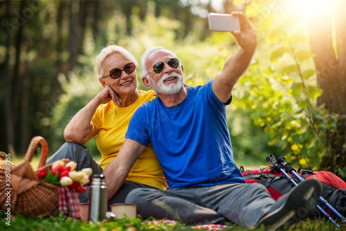 Senior couple enjoying in a good mood in the park