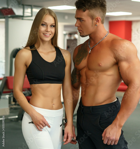 Fototapety, obrazy: Time to train. Athletes posing in fitness center