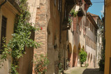 Fototapeta Uliczki - narrow street in old town of italy