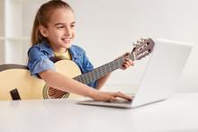 Cheerful Girl With Guitar Usin...
