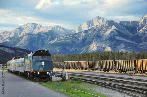 Passenger train stands on Jasper station. Canada. Canvas Print