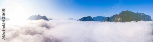 Obraz Aerial panoramic Nam Ou River drone flying over morning fog mist and clouds, Nong Khiaw Muang Ngoi Laos, dramatic landscape scenic pinnacle cliff, famous travel destination in South East Asia - fototapety do salonu