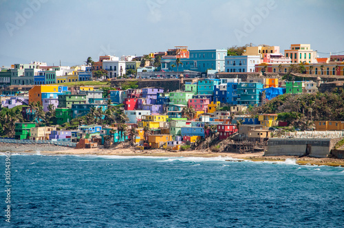 Fototapeta Colorful houses line the hill side overlooking the beach in San Juan, Puerto Rico. obraz