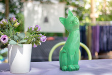 Green Cat Statue On The Table