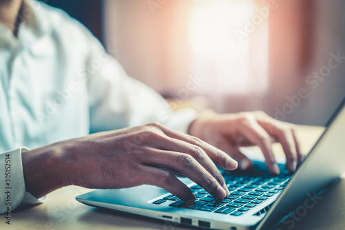 Businessman hand typing on computer keyboard of a laptop computer in office Canvas-taulu