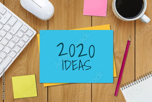 New Year Resolution Goal List 2020 - Business office desk with notebook written in handwriting about plan listing of new year goals and resolutions setting Wallpaper Mural