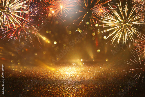 Door stickers Countryside abstract gold, black and gold glitter background with fireworks. christmas eve, 4th of july holiday concept