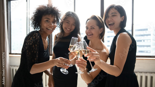 Poster de jardin Alcool Happy beautiful women hold glasses look at camera celebrate party