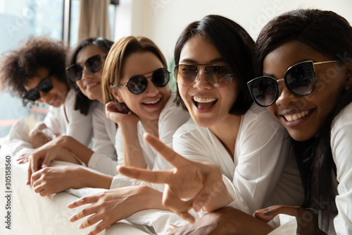 Photo Stands Akt Happy young adult attractive ladies wear sunglasses looking at camera