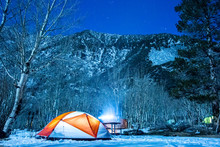 Illuminated Tent In Snow With ...