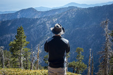 Hiker With Wide-Brimmed Hat At...