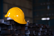 Yellow Color Safety Helmet On Steel Bars In Construction Site, Safety Helmet With Steel Structure