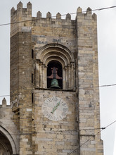 Bell Tower With Clock In A Church In Lisbon