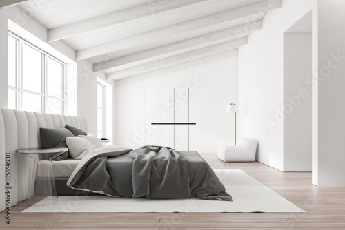 White ceiling attic bedroom interior Fototapeta