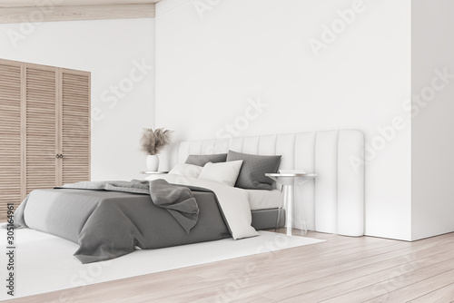 Fotografija White master bedroom corner with wardrobe
