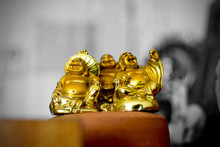 Miniature Laughing Buddha Models On N Earthen Base