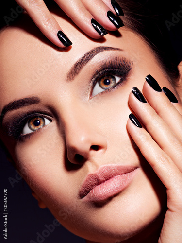 face-of-a-beautiful-girl-with-fashion-makeup-and-black-nails