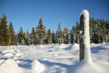 Wooden Pole Covered With Snow....
