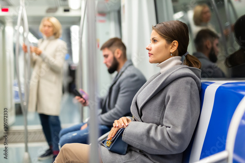 Fototapeta Pretty woman in public land transport